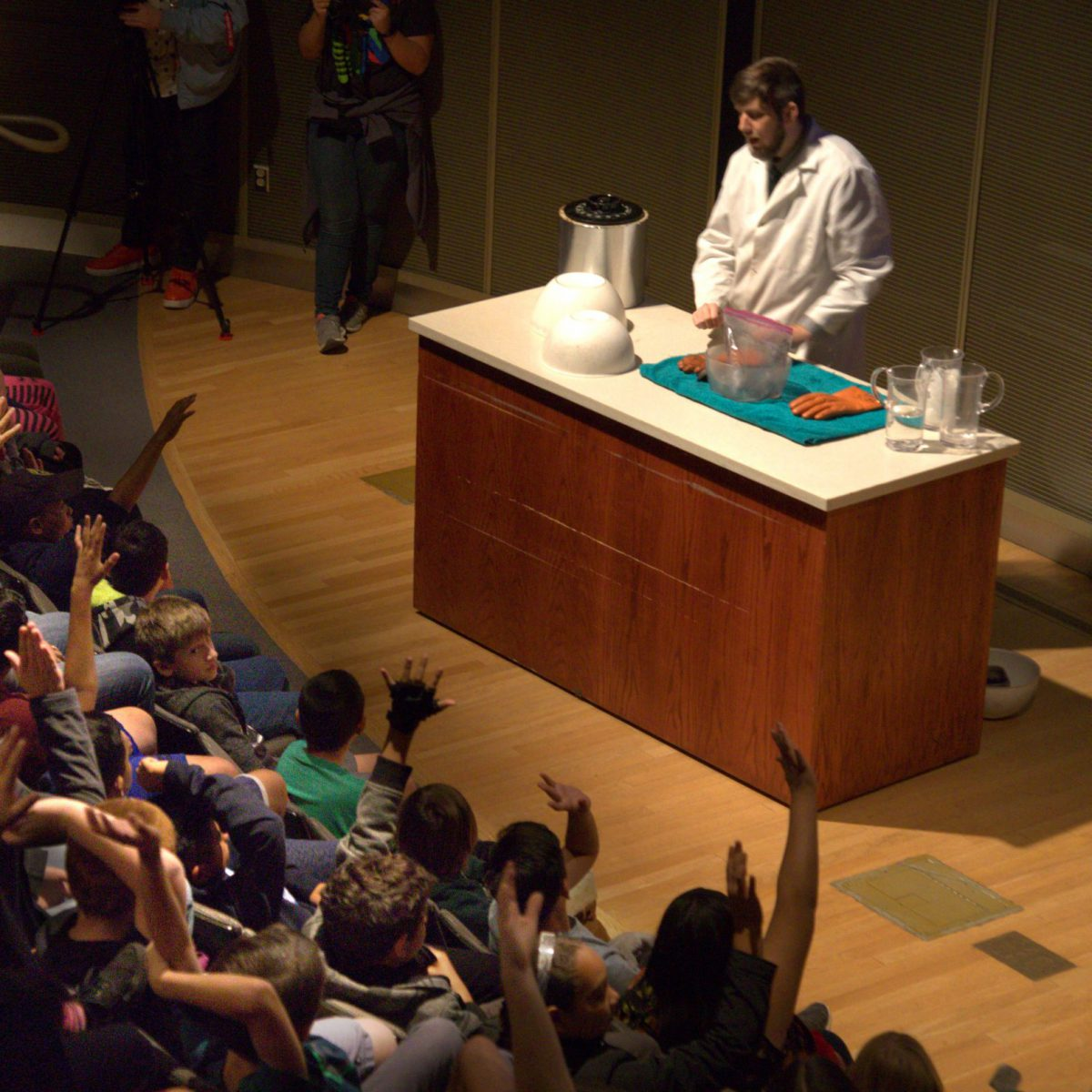 A crowd watches a live science demonstration at the Griffith Observatory.