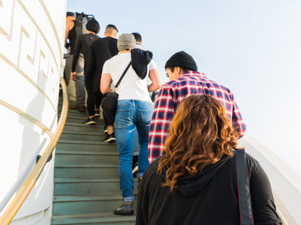 People climbing Observatory stairs. Photo by Levi Jones (https://unsplash.com/photos/n0CTq0rroso)